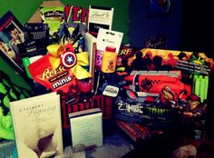 The Man Basket!  This gift went over great for Anniversary!  Filled with Beer, Sriracha, energy drinks, vitamin water, Nerf Gun, T-shirts, Action DVD, Wasabi treats.