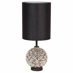 "Illuminate your living room, bedroom, or den with this sculptural table lamp, showcasing a mercury glass base and contrasting drum shade. Let it brighten your desk or arm chair, or use a pair to flank your console.  Product: Table lampConstruction Material: Mercury glass and fiberColor: Silver and blackAccommodates: (1) 100 Watt bulb - not includedDimensions: 27"" H x 14"" Diameter"