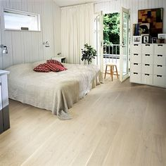 Engineered wood flooring in beautiful, white-washed Scandinavian style