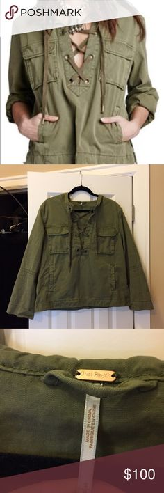 Free People Safari Lace Up green pull over Pull over green jacket by Free People. It's the Safari Lace Up style with pockets and a good. Bought and worn once!!! Extremely cute, size small so I'm reselling. A little bit of a baggy style not fitted! Free People Jackets & Coats