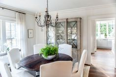 From the Spanish chandelier in the gray-and-white kitchen to the substantial wooden furniture found throughout the space, Mediterranean elements in this home give it a flavor all its own.