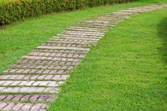 Google Image Result for http://us.123rf.com/400wm/400/400/wuttichok/wuttichok1009/wuttichok100900050/7773953-garden-stone-path-with-grass.jpg