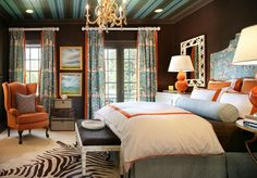 blue and coral bedroom | This bedroom design uses the blue on the walls and accents with orange ...