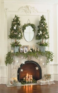 Christmas mantel. I adore the inclusion of vintage photographs in this sweet, elegant Christmas! ~ christmas, decor, display, fireplace, green, vintage, white