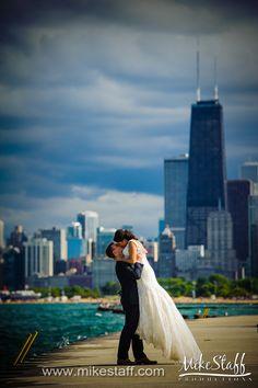 Groom lifts bride with city skyline background #Michiganwedding #Chicagowedding #MikeStaffProductions #wedding #reception #weddingphotography #weddingdj #weddingvideography #wedding #photos #wedding #pictures #ideas #planning #DJ #photography #bride #groom