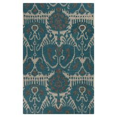 Hand-tufted wool rug with an ikat motif. Made in India.  Product: RugConstruction Material: WoolColo...