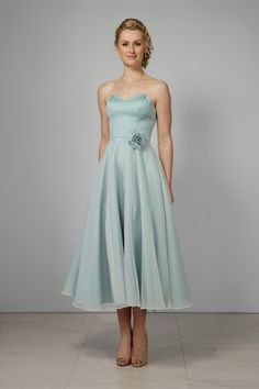 This elegant tea-length bridesmaid gown has a fitted satin sweetheart bodice which flows into a graceful A-line tea-length skirt. Organza Dress, Satin Dresses, Strapless Dress Formal, Gowns, Formal Dresses, Tea Length Skirt, Tea Length Dresses, Simple Elegance, Elegant