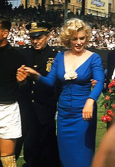 Marilyn Monroe - May 12, 1957 - performing the ceremonial kick-off at Brooklyn Dodgers' Ebbets Field for the All Star soccer match between the USA national team and Israeli club Hapoel Tel Aviv - holding hands with Israeli goalkeeper Ya'acov Chodorov (Israel, 1927)