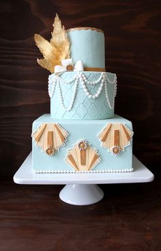 Roaring 20s Wedding: Great Gatsby inspired cake...I don't care for the colors but maybe in ivory and gold