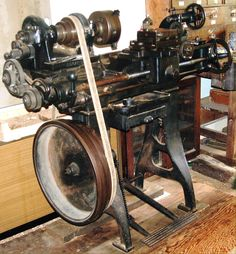 "A ancient foot-powered metalworking lathe; I once read that in a large English ""Engineering Firm"" (i.e., machine shop), all apprentices were required to learn to use such a lathe primarily to teach them how important sharp tooling was. Notice that the lathe was designed to have flowing, rather decorative lines, rather than the boxy castings one encounters these days."
