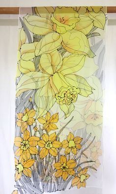 For the full collection, visit us at: www.silktakuyo.com Delightful drawings of Yellow Daffodil flowers are perfect for Spring Wedding. Many shades of yellow colors are used to depict this large oversized silk scarf. A generously sized silk scarf (22x90 inches) can be worn as a