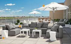 Our Oasis sectional offers a lot of seating in this large outdoor space and individual pieces can be rearranged as your needs change. The sectional's shape helps separate the lounging area of this deck from the dining area.