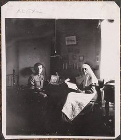 Alexei and Claudia Bitner photographed during lessons in the Governor's Mansion, Tobolsk 1917.