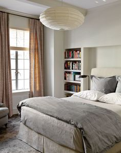 A second bedroom gets a clean contemporary look, with integrated plastered walls and shelves that create an alcove/headboard.  To see more of our general contracting and construction projects, visit http://www.bestandcompanynyc.com/