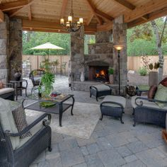 view of fireplace in gazebo outdoor living room   www.paradiserestored.com