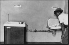 Segregated Water Fountains Photographer: Elliott Erwitt, Magnum Photos Picture of segregated water fountains in North Carolina taken by Elliott Erwitt.