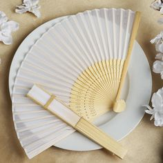 Add a classical Asian touch to your wedding, or a special event by presenting your esteemed guests with this special souvenir. Our stylish silk wedding hand fan is intricately handcrafted with a bamboo structure. The framing and spines are crafted from hand-picked bamboo and durably glued with a seamless cut piece of silk to fashion this immaculate magnum opus. Give these swish fans to your respected guests and let them create the lasting memory for the years to come. The fans are very…