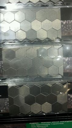 Really digging the hexagon stainless steel backsplash!! Very cool, self stick and no grouting!