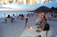 Experience an exquisite romantic dinner in Aruba at Passions on the Beach. This beachfront dining experience is complemented by the soft light of torches, sugary white sand between the toes, soft sounds of waves and a beautiful sunset. Along with excellent service this Aruba restaurant on the beach creates an unforgettable dining experience in the Caribbean.