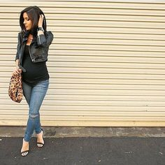 Stay true to you and your style for maternity photos - this cropped moto jacket looks sharp over a fitted tee!