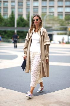Tan trench, lace dress, and sneaks.