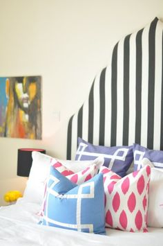 this simple striped headboard would look bland without the graphic element of the geometric pillows