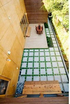 geometry creates an outdoor room  Pavers with grass between to define space around decking