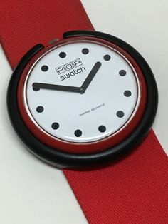 This was my pop  swatch. I wore it as a large tie pin, on suspenders, or on ribbon as a bolo with a men's button down. Must get another!Pop Swatch Watch Fire Signal BR001 1986 by ThatIsSoFunny