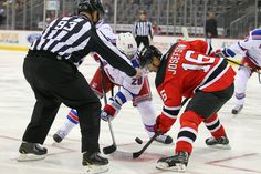 CrowdCam Hot Shot  New York Rangers center Dominic Moore and New Jersey  Devils center Jacob Josefson face off during the first period at Prudential  Center. 2405fbf92
