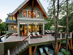Two sets of French doors connect the great room to the back deck, which is elevated 10 feet above ground level and boasts stellar views of marshland.