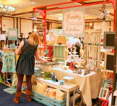 vintage craft booth - note the red frame to showcase hanging light fixtures