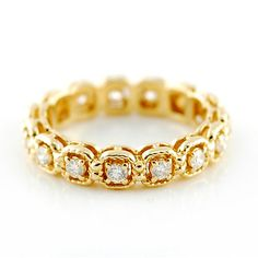 Rope Edge Halo Look Diamond Eternity Band.  Gorgeous eternity band with round brilliant diamonds, set in 14 karat yellow gold. Each diamond is surrounded by a roped halo, giving this band a very unique look.  .50ctw