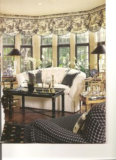 Love this French Country Living Room, from the toile valances to the black metal lamp shades. Black and white are always a classic combination.