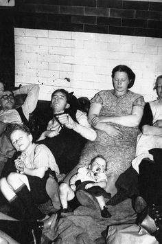 A London family stretches out on the platform of a subway station in London, Sept. 20, 1940, seeking sleep during a night of air raids. All except the baby have their eyes closed. This air raid shelter, regarded by Londoners as bomb proof because of its depth in the ground, is one of the Not de Luxe havens. (AP Photo)