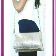 Gold crossbody purse made of vegan leather and chic as ever with black leggings and a basic white tank top.  WWW.LUXEANDVAIN.COM