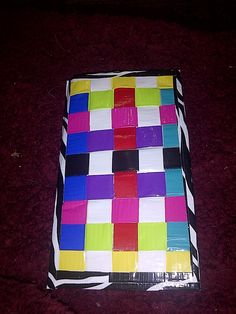 front & back of a woven duck tape CD case I made for my sister.