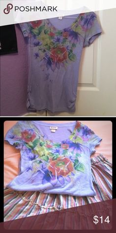 Floral V-Neck Tee Purple v-neck t-shirt with flowers on it. Can be dressed up or dressed down. Used but in good condition. PLEASE READ THE ENTIRE DESCRIPTION BEFORE PURCHASING! 🚫 NO TRADES. NO HOLDS. NO MERC@RI 🚫📩 I only respond to offers made through the offer button 📩  🙋🏼Questions? Just ask! Serious inquiries only please. EVERYTHING MUST GO!! 💁🏼 Mossimo Supply Co. Tops Tees - Short Sleeve