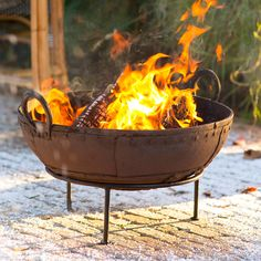 """Placed on the included stand or directly on the ground, this iron fire pit is a practical and portable addition to the backyard thanks to a pair of handles for easy repositioning.- Iron- Please note: bowls are one-of-a-kind objects, size, shape, and finish may vary.- ImportedSmall: approximately 9""""D, 26"""" diameterLarge: approximately 10""""D, 32"""" diameterStand: 6""""H, 16"""" diameter"""