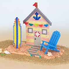 This simple beach cottage scene makes the cutest display for your summer decorating. Quick and easy assembly!