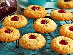These delicious chewy coconut jam drops biscuits are easy to make and great for morning tea. The cookies are complete with a raspberry jam centre. Coconut Biscuits, Coconut Cookies, Mayonaise Biscuits, Jam Cookies, Cookies Et Biscuits, Drop Cookies, Jam Drop Biscuits, Easy Biscuits, Recipes For Biscuits