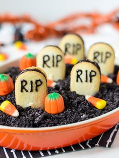 """A dessert dip that tastes like a chocolate cheesecake. Top this cheesecake dip with Oreo """"dirt"""" and cookie """"tombstones"""" for a Halloween treat."""