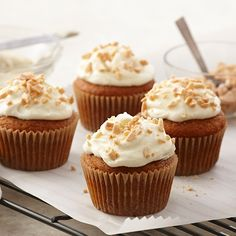 These cinnamon-spiced pumpkin cupcakes are topped with a generous mound of  fluffy almond cream cheese frosting and toasted almonds.