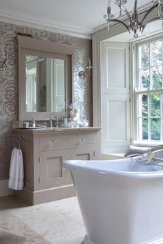 As seen the in the French bedroom previous the damask brown wallpaper with regal candle lights, taupe tone sink unit and classic role top bath both scream and shouts elegance. But as it is sometimes the case it's important not to overdo it, less is more.