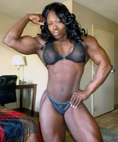 Black Goddess flexes her muscles in bikini