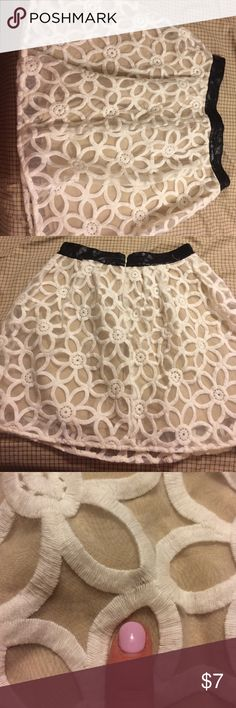 Skirt Used, a couple minor stains. Pins and Needles brand skirt. Like an ivory overland with a cream underlay. Black on top. Pins & Needles Skirts