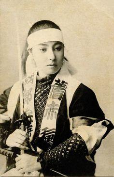 Samurai holding a katana (1900)