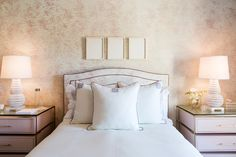 Custom lacquered night tables, linens, headboard and wallpaper