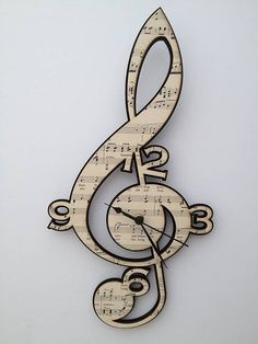 Treble Clef Vintage Music Clock by Neltempo: Genuine vintage music mounted onto birch plywood & cut using laser technology. Treble Clef Vintage Music Clock by Neltempo: Genuine vintage music mounted onto birch plywood & cut using laser technology.
