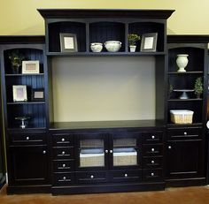 Entertainment Center. Copy this with inexpensive components -- old dresser, 3 small book shelves, crown molding.