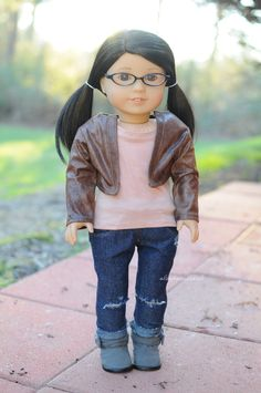 Tee and jeans by Sparrow and Wren, jacket by Buzzin' Bea and boots are AG brand. American Girl